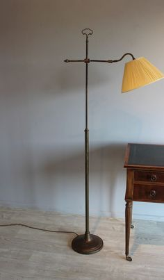 Brass adjustable  reading light with pleated shade