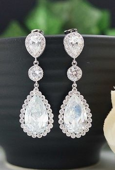 My wedding earrings just minus the bordering diamonds around the largest stone
