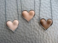 Barbie boob heart necklace ... really? What is wrong with the person who came up with this? The entire website is messed up!