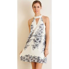 New The Bebe Dress This is perfect for dress season coming up with all the weddings, graduations and summer festivals. Floral print chiffon dress with cutout on bust. High round neck and keyhole on back with hook & eye closure. Fully lined. Non-sheer. Woven. Lightweight. Dresses Midi