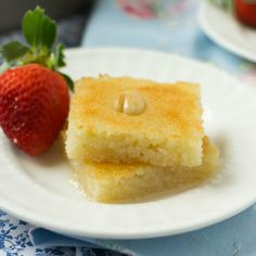 Eggless semolina and coconut cake, drenched in rosewater and orange blossom syrup. Easy to make, very moist, great for tea time or a brunch!