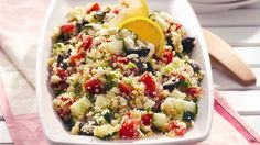 Quick-cooking couscous lends to the 20-minute prep time of this Greek-style salad.