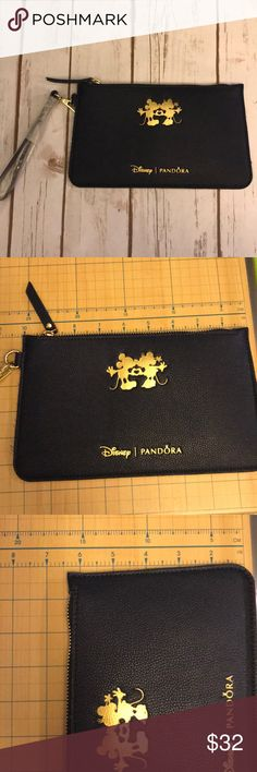Limited Edition PANDORA Mickey & Minnie Clutch Authentic and new/unused. PANDORA Disney Mickey and Minnie navy blue colored clutch/pouch. Material is FAUX LEATHER.  See pics for measurement. Protective cover still on strap. Smoke free home. Disney Bags
