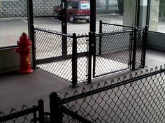 Airlocks: These are perfect for areas without a fence. You've probably seen airlocks at your local dog park or boarding facility. These handy gated areas are built in front of your main entrance, so that if the door opens and a dog escapes, they are still Dog Boarding Kennels, Pet Boarding, Indoor Dog Park, Cheap Dog Kennels, Dog Kennel Cover, Dog Salon, Dog Fence, Dog Proof Fence, Dog Daycare