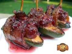Atomic Bombs  -bacon wrapped sausage, cream cheese and jalapenos...topped with hot raspberry bbq sauce
