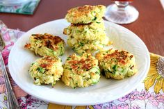 Zucchini Cakes: large zucchini, grated 1 large egg 1 cup panko bread crumbs Salt/pepper 1/2 cup Parmesan cheese, grated