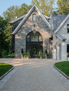 Isn't this home absolutely stunning? The exterior paint color is Benjamin Moore La Paloma Gray, darkened by 25 %. Brooks and Falotico Associates, Inc.