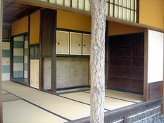 Another interior view from the Katsura Imperial Villa, Kyoto, Japan.  Note the yellow ochre color, contrasting with a blue/white checkerboard and then plain panels with faded paintings on them.