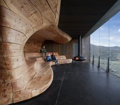 The rippled timber core of this reindeer observation pavilion by architects Snøhetta mirrors the curves of the surrounding Dovre Mountains in Norway