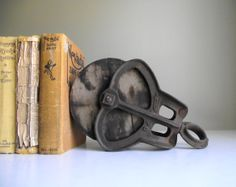 Industrial Pulley Bookend Antique Cast Iron and Wood Barn Pulley on Etsy, $42.00