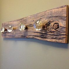 Old door knobs and barn board.  I prepped the door knobs, son made the base and hung it up.