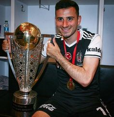 Oguzhan Ozyakup with champion cup