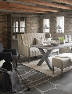 Exposed brick, slate floors and grey textures.