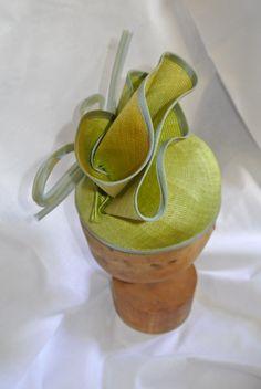 fascinator hat made from vintage parisisal straw hat with silk organza trim.