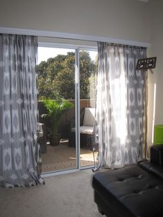 how to cover ugly vertical blinds ... hate the blinds on our sliding glass door ... may need to try this.