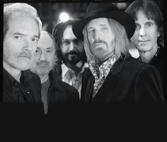 Mudcrutch are: Benmont Tench, Randall Marsh, Mike Campbell, Tom Leadon, and last, but definitely not least, our beloved Tom.   Ron was not a part of this band prior to the Heartbreakers. We got some entries from people who thought he was part of this lineup.   Thanks again for participating!