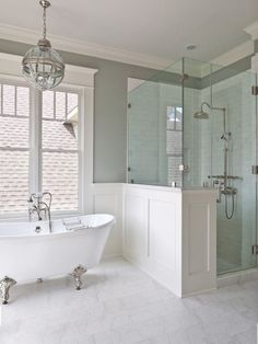 Gorgeous bathroom with an open and spacious feel and the claw foot tub with the pendant overhead adds a layer of luxury.: