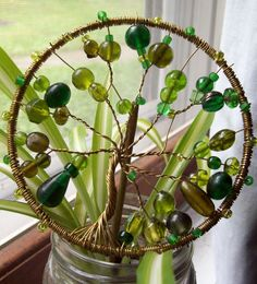 Glass sun catcher. This would be cool to do with my handmade glass beads, since I can never get them to match!