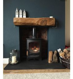 Fireplace Finished Charnwood C-Four Riven Such a cosy fireplace with a slate hearth, exposed brick & rustic oak beam. Love the dark blue wall and home accessories, too! Home Living Room, Living Room Decor, Living Room Wall Colours, Blue Feature Wall Living Room, Cozy Living Room Warm, Log Burner Living Room, Kitchen Living, Cosy Fireplace, Fireplace Ideas