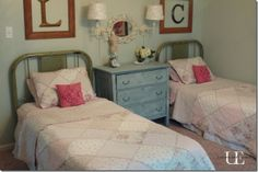 Love the twin iron beds. Love the letters above