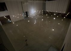Rafael Lozano-Hemmer uses robotics, LED screens, and film projections to disturb the uniform conditions in which people interact in groups. For the above Pulse Room, Lozano-Hemmer built an array of incandescent light bulbs that flashed at the exact rate of a participant's heart when he or she held an interface placed on a side of the room.