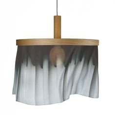 Pendant Design by Nicolette Brunklaus . Available in six designs, providing a personal completion in any modern or classic interior. The silk banners are interchangeable and can be ordered separately; a simple yet refined system allows you to change your interior in moments.