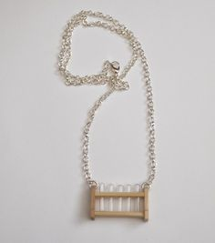 TEST TUBE NECKLACE. This is the coolest thing ever. I must quietly steal test tubes from my lab at uni and make one...