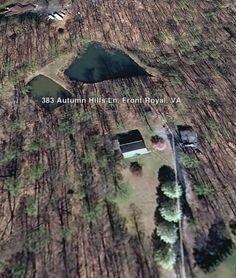 Aerial image showing home, detached garage, and 2 stocked ponds