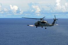 File:US Navy 070811-N-2659P-013 An SH-60F Seahawk, assigned to the Eightballers of Helicopter Anti-Submarine Squadron (HS) 8, fires a Hellfire Air-to-Ground Missile at a target during exercise Valiant Shield 2007.jpg