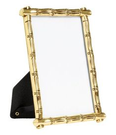 Gold-colored. Photo frame in bamboo-look metal. Stand and loops at back for hanging. Screws not included. Fits pictures up to 3 1/2 x 5 3/4 in. Outer
