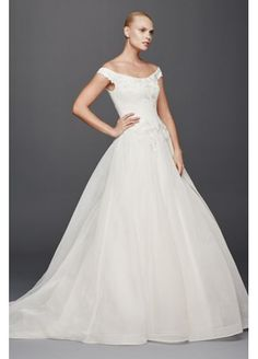 Love the off the shoulder style of this wedding dress from the Truly Zac  Posen collection d9b9046b7499