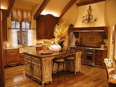 I am loving the exposed beams and cabinetry!!