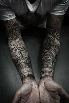 dotwork tattoo on arms