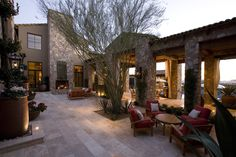 This courtyard provides a welcoming outdoor space for a rambling Ranch Hacienda in north Scottsdale's Silverleaf.   Silverleaf Estate Embraces Indoor/Outdoor Living | Drewett Works Architect: C.P. Drewett, AIA, NCARB