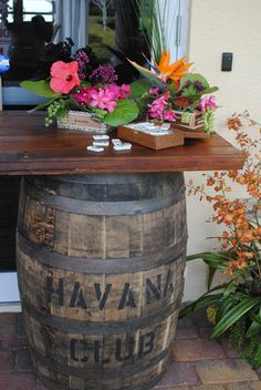 Havana nights party deserved rum barrels and tropical flower arrangements @truelovedecor