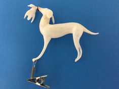 A clip-on milk glass dog with a duck or goose. The bird is a separate piece with a small spike that fits into the dog's mouth. Glass Ornaments, Milk Glass, Separate, Glass Art, German, Birds, Dogs, Deutsch, German Language