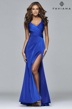 Faviana 7954 is classic and alluring. A stunning option for every body shape, this faille satin prom dress features a V neck with just the right amount of plunge, side slits, and a draped long skirt.