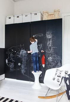 Why not paint the wardrobe doors? If you've got old wardrobes that need a little love, the chalkboard paint will also make them look fresher and your kids will have a nice big space to draw on. The best part is, this can work even in the smallest room. And if not a wardrobe door, the door to the kids room will work equally well.