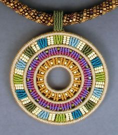 Colorful, detailed micro-macramé jewelry by Joan Babcock is  truly one-of-a-kind work