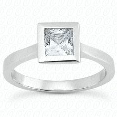 Thin bezel set princess cut engagement ring available at Wheat Jewelers