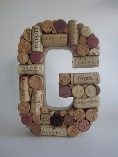 Wooden letter with corks hot-glued on... Cute idea!