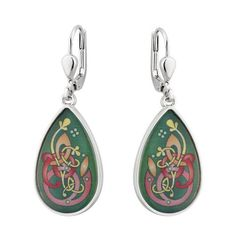 """These earrings capture the eternal color of the Book of Kells by using enamel to craft a Kells-inspired pattern. The rest of the earrings are plated with rhodium, giving them a tarnish-resistant shine. Hanging from leverback hooks, which will stay securely from the wearer's ears, the earrings measure ½"""" wide x ⅞"""" tall. These Irish earrings come in a gift box, and make a great gift for anyone who loves Ireland! Made by Solvar Ltd. in Dublin, Ireland"""