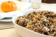 Wild Rice and Mushroom Stuffing--substitute veggie broth for chicken, leave out the fruit and I think it sounds delicious!