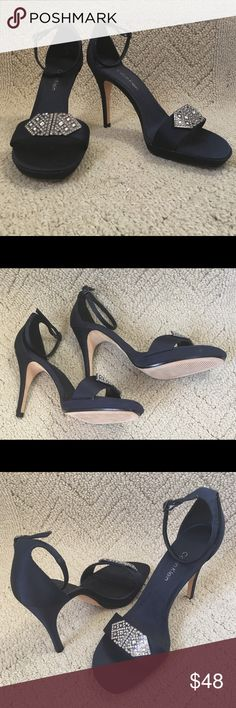 "Calvin Klein Navy Blue Satin Heels (NWOT) These NEW Calvin Klein navy blue satin art-deco inspired platform heels will give you the extra polish you need for that special night out. The 4"" heel along with the 1/2"" platform will give your legs the long and sexy look we all desire. Calvin Klein Shoes Sandals"