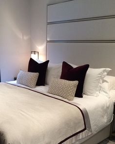 Master Bedroom nearly complete at one of our projects in Little Venice! Love the pops of deep Merlot red accessories! The headboard looks so smart with the metal detailing! #cushions #red #merlotred #accessories #masterbedroom #bed #headboard #interiordesignideas #interiordesign #design #luxurydesign #inspiration #olivedesignstudio