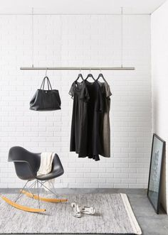 Interior Design Idea - Coat Racks That Hang From The Ceiling // Steel cords and a stainless steel rod make up these minimalist hanging clothing racks. They can come as a single hanger, a dual hanger, or a corner hanger, all of which are adjustable making them convenient at your front door, in your bedroom, or in a tight corner.