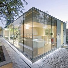 A herb garden surrounds this glass-fronted spa in Santiago by Chilean studio LAND Arquitectos.