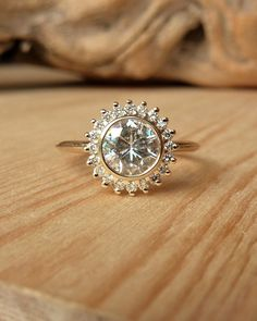 Bezel Set Moissanite and Diamond Halo… I'm currently in love with the idea of Moissanite, so much more affordable than a diamond