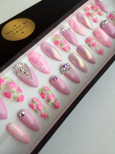 Pale pink floral glitter almond nails