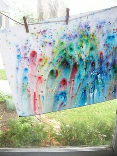 To make rain paintings  you crush up watercolor paints (we put them in plastic bags and banged on them with a rolling pin), sprinkle them on some paper and put it out in the rain.